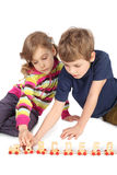 Boy and girl playing with wooden railway Stock Photo
