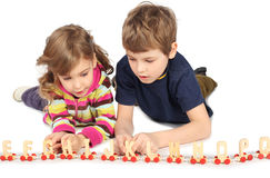Boy and girl playing with wooden railway Stock Image