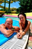 Boy and girl in the pool. Happy couple in the pool Stock Images