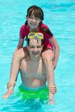 Boy and girl in the pool Stock Photo