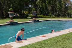 Boy Girl Pool Playing Royalty Free Stock Photography