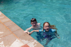 Boy Girl Pool Playing Stock Photos