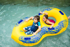 Boy and girl in a pool Royalty Free Stock Image
