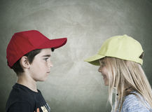 Boy and girl. Portrayed in the same plane Royalty Free Stock Photo