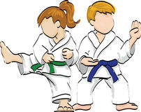 Boy and girl practicing martial arts Stock Image