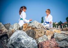 Boy and girl practising yoga on beach Royalty Free Stock Image