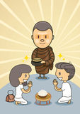 Boy and girl praying from monk Royalty Free Stock Photo