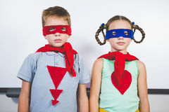 Boy and girl pretending to be a superhero. Portrait of boy and girl pretending to be a superhero Royalty Free Stock Images