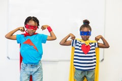 Boy and girl pretending to be a superhero Stock Images