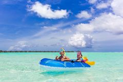 Boy and girl in raft Royalty Free Stock Photo