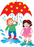 A boy and girl in the rain with an umbrella. A cartoon boy and girl in the rain with a large red spotted umbrella Stock Photo