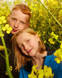Boy and girl in rape field Royalty Free Stock Photography