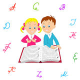 Boy and girl read with interest the book. Royalty Free Stock Image