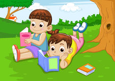 Boy and girl reading Stock Photography