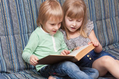 Boy and girl are reading book Stock Photo