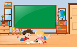Boy and girl reading book in class Stock Image