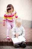 Boy and girl reading a book Stock Photo