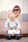 Boy and girl reading a book Royalty Free Stock Photography
