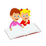 Boy and girl are reading a book Stock Photography