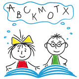 Boy and girl reading a book together Royalty Free Stock Photos