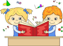 Boy and girl reading book together Stock Photo