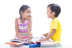 Boy and girl reading books Stock Photos
