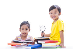 Boy and girl reading books Stock Photo