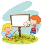 Boy and girl reading Royalty Free Stock Photos