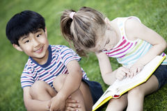 Boy and girl reading Stock Image
