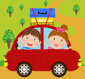 Boy and girl in red car Stock Photography