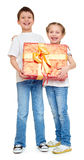 Boy and girl with red gift box and golden bow - holiday object concept isolated Royalty Free Stock Photography