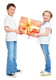 Boy and girl with red gift box and golden bow - holiday object concept isolated Stock Image