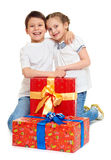 Boy and girl with red gift box and golden bow - holiday object concept isolated Royalty Free Stock Image