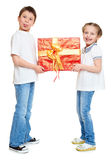 Boy and girl with red gift box and golden bow - holiday object concept isolated Stock Photos