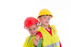 Boy and girl with reflective vest and helmet Royalty Free Stock Photos