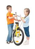 Boy and girl repair bicycle isolated Royalty Free Stock Photography