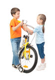 Boy and girl repair bicycle isolated Royalty Free Stock Images