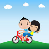 Boy and girl ride bicycle. In happy face Stock Photo