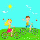 Boy and girl riding on a bicycle Royalty Free Stock Photo