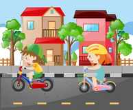 Boy and girl riding bike on the road Royalty Free Stock Images