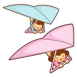 Boy and girl is riding a hang gliding in the sky. Education and Royalty Free Stock Image