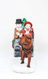 Boy and girl riding the Horsecar ,Christmas decoration ceramics, Stock Photography