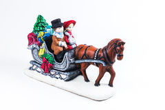 Boy and girl riding the Horsecar ,Christmas decoration ceramics, Stock Photos