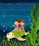 Boy and girl riding on turtle underwater. Illustration Stock Images