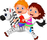 Boy and girl riding a zebra Royalty Free Stock Photos