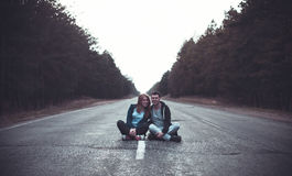 Boy and girl on a road Stock Image