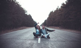 Boy and girl on a road Royalty Free Stock Photography
