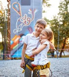 Boy and girl  in  rock climbing gym Royalty Free Stock Photography