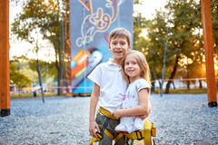 Boy and girl  in  rock climbing gym Royalty Free Stock Image