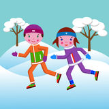 A boy and a girl run in the winter in a park among trees in the. A boy and a girl take care of their health and run in sports clothes in the winter in a park Stock Photos